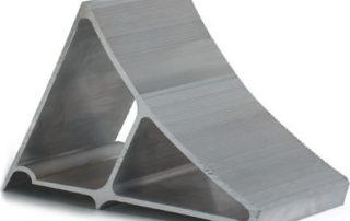 Close-up view of metal wheel chock (trailer restraint)