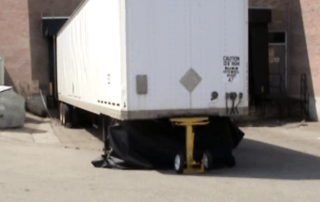 AutoStand Plus holding up a trailer with collapsed landing gear
