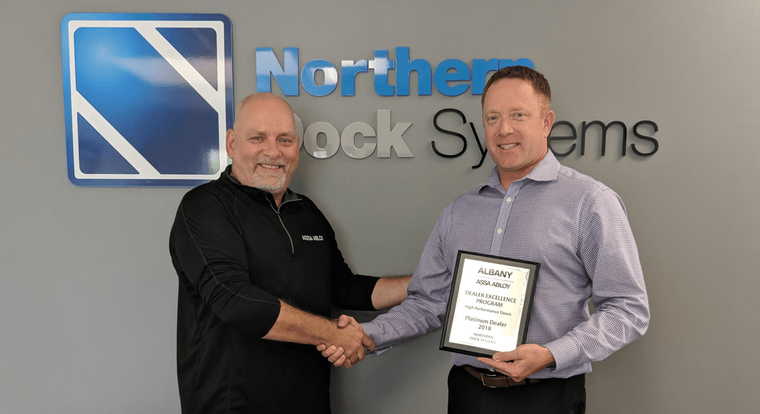 Representative from Assa Abloy presenting the Dealer Excellence Award to NDS VP of Sales and Marketing, Chris Brady