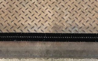 Spiral brush weather seal for dock levelers