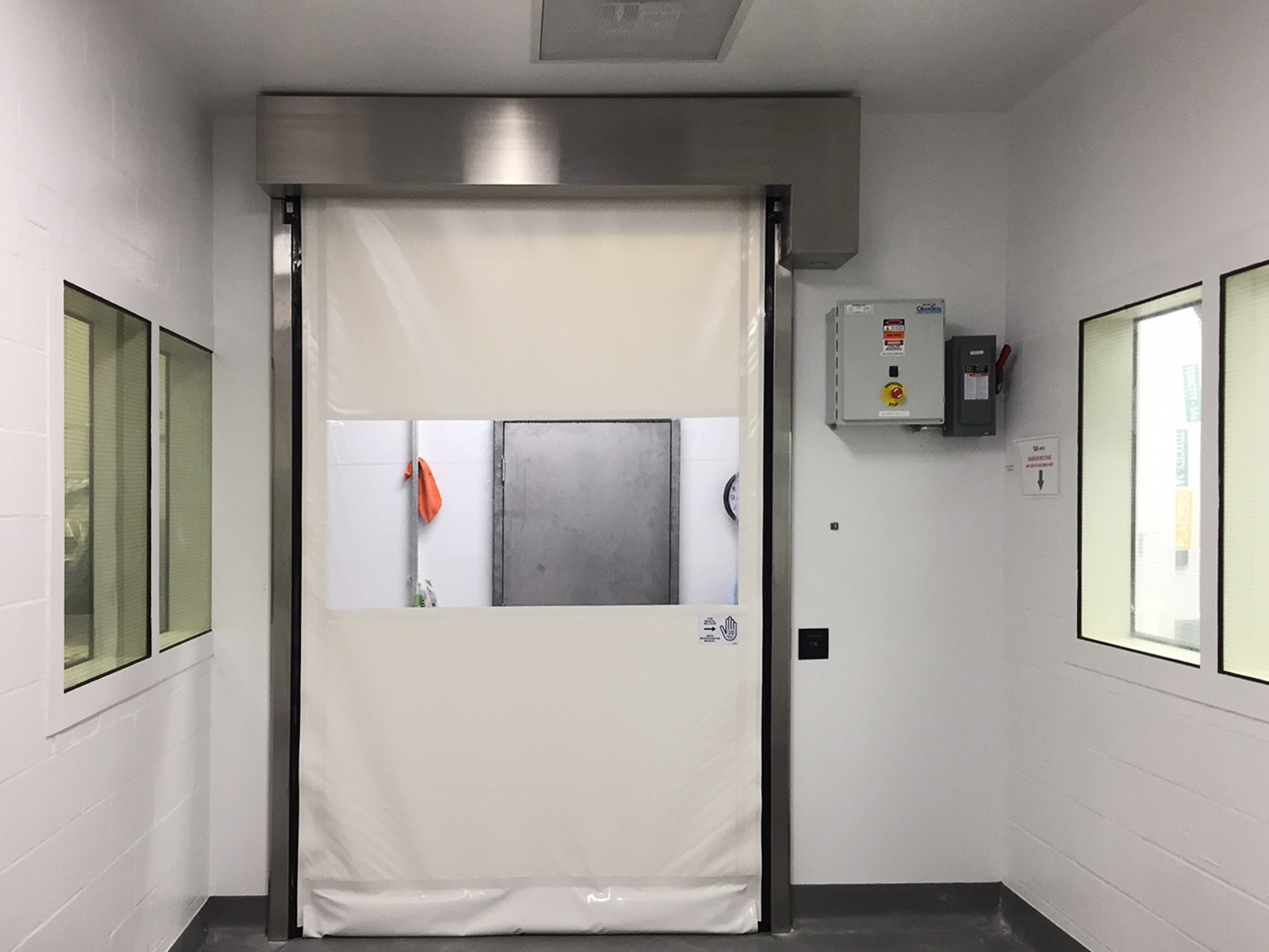 pharmaceutical fabric roll up door with touchless entry