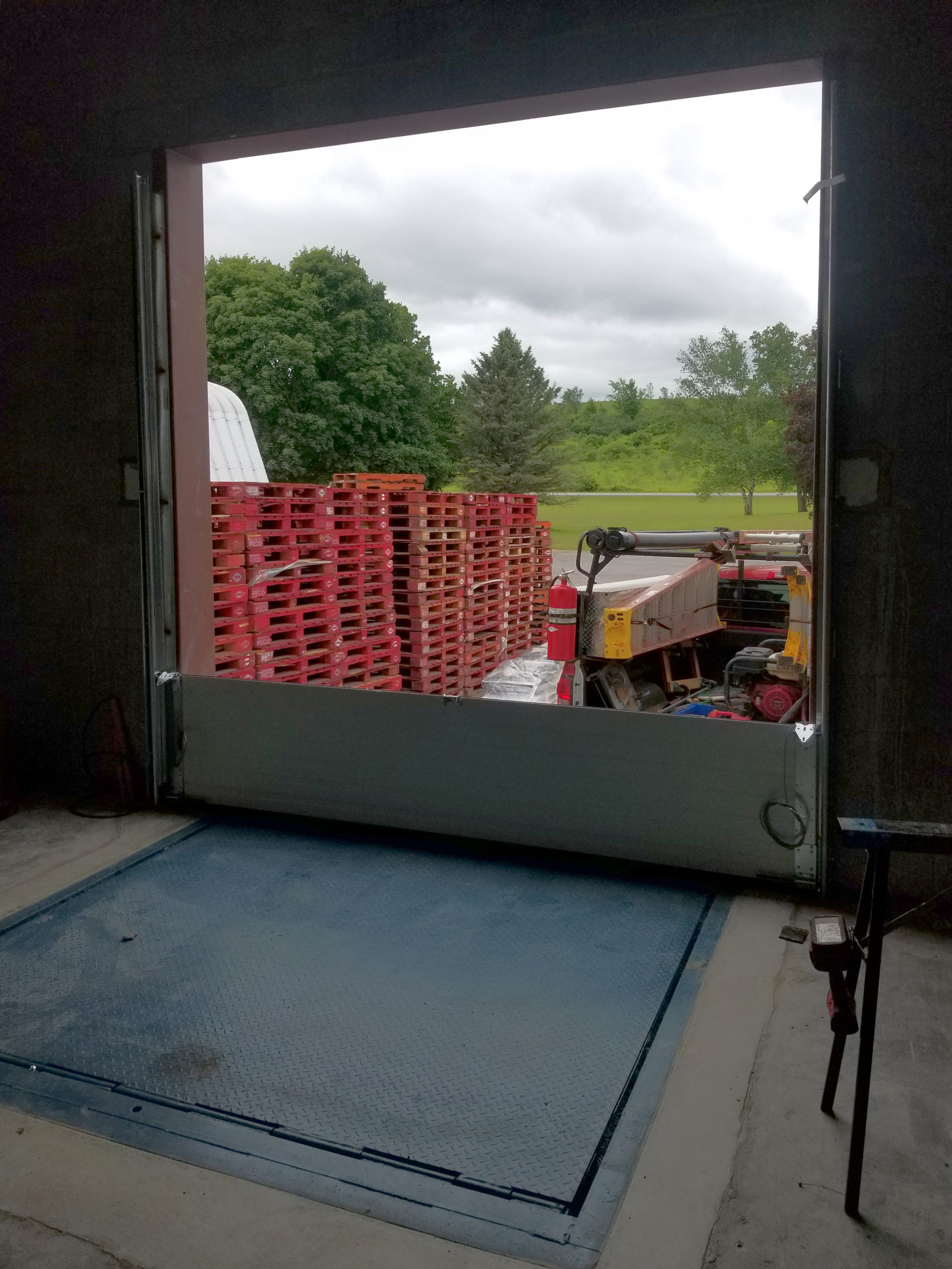 Adding the first section of the insulated steel sectional door