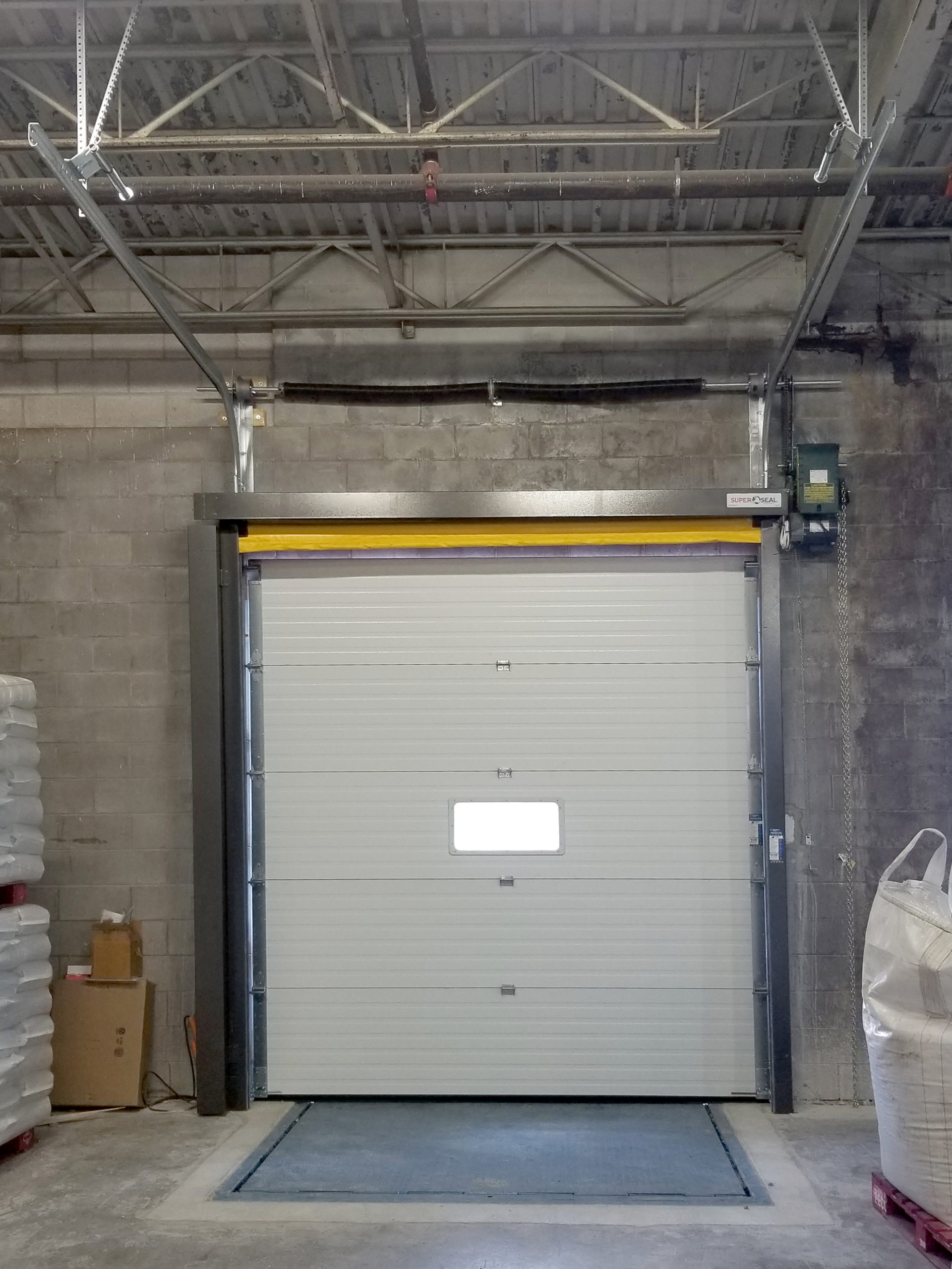 Completed new loading dock position from inside with bug door