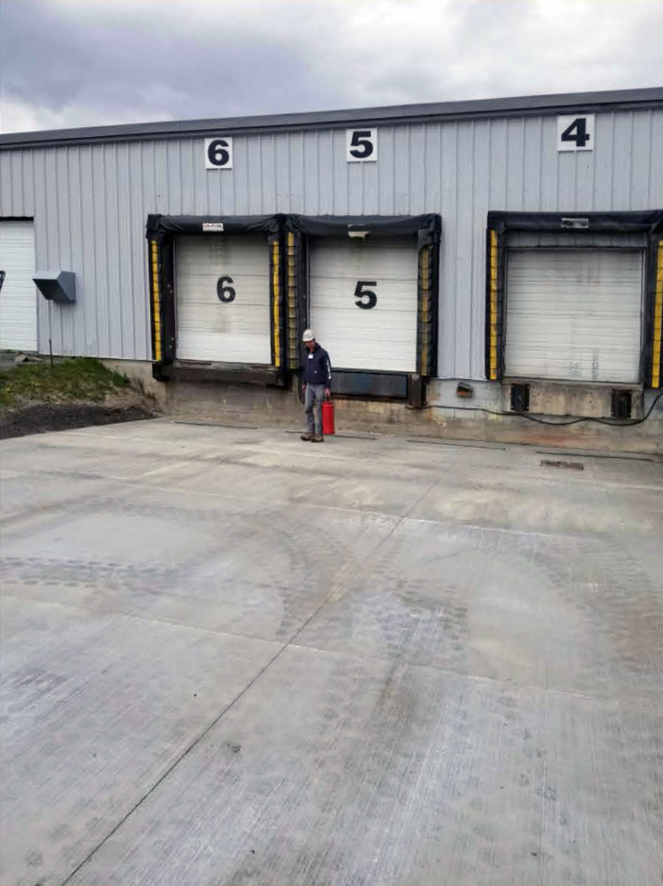manufacturing plant outside with no vehicle restraints or dock leveler