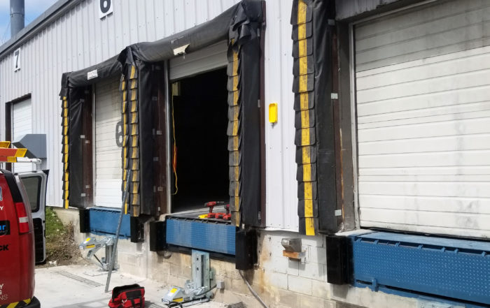 install MTL mechanical vehicle restraint and heavy-duty hydraulic dock leveler