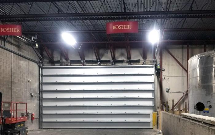 Large steel sectional overhead door hubberts inside