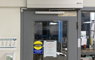 warehouse manufacturing plant touchless wave sensor automatic swing door lunchroom
